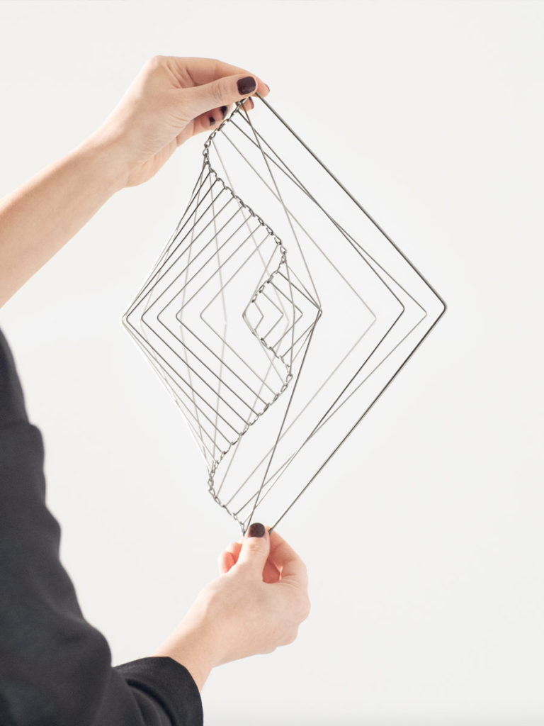 Metallic Silver Square Wave, the mind bending kinetic sculpture that mutates into beautiful shapes and patterns when you spin it.